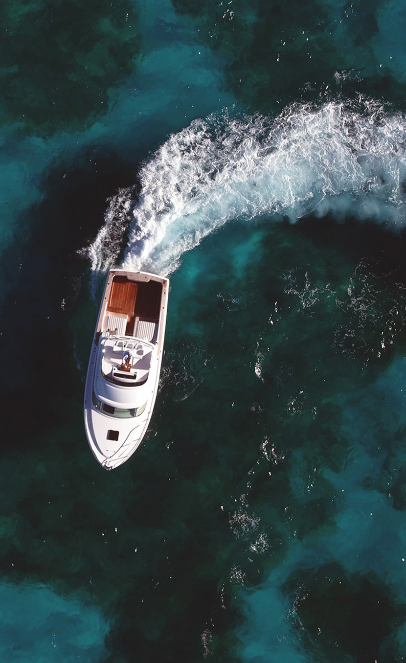 Overhead shot of boat leaving a wake.