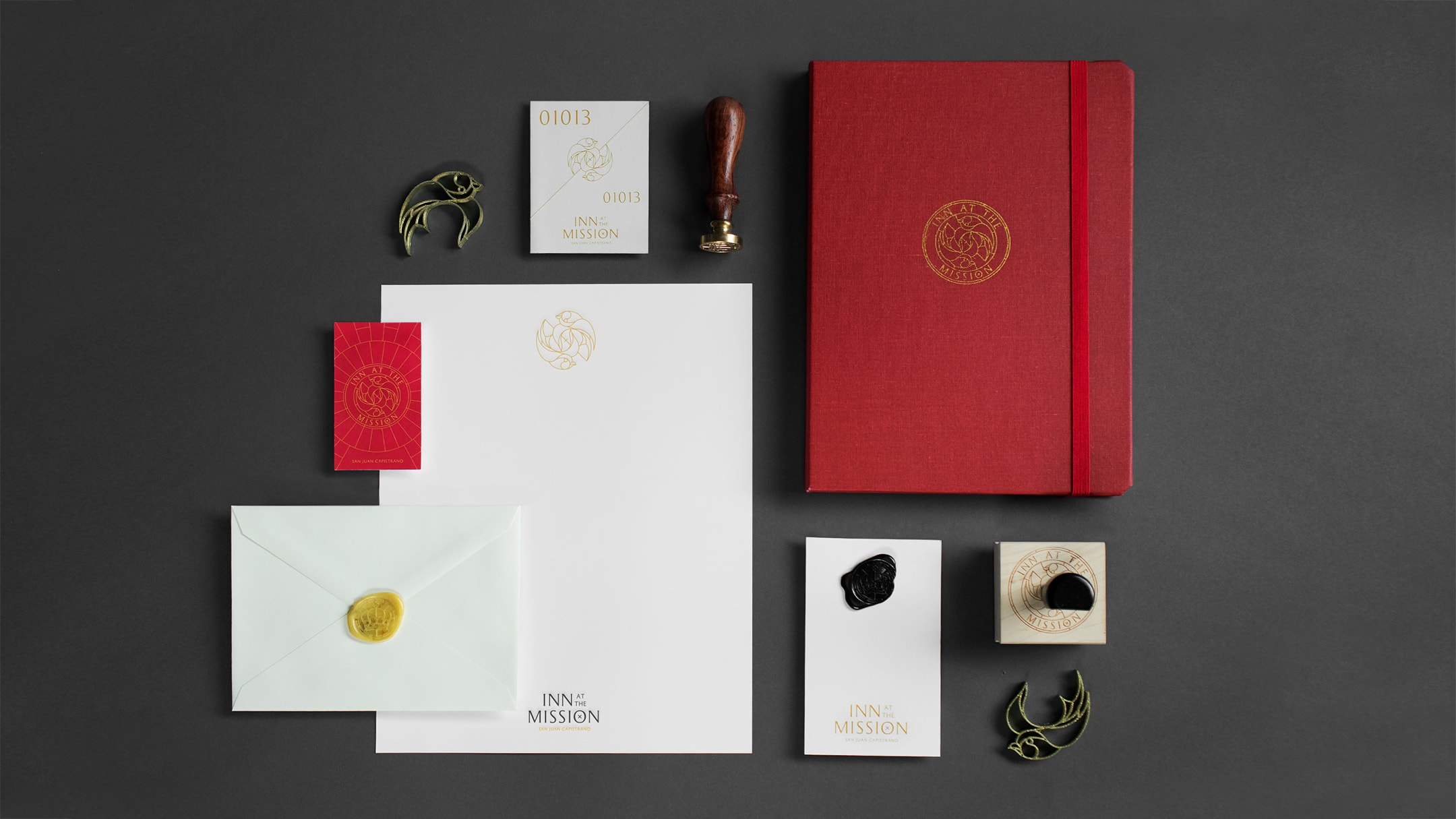 A sample of the hospitality branding work done for Inn At The Mission including sales collateral, notebook, notepads, wax stamp