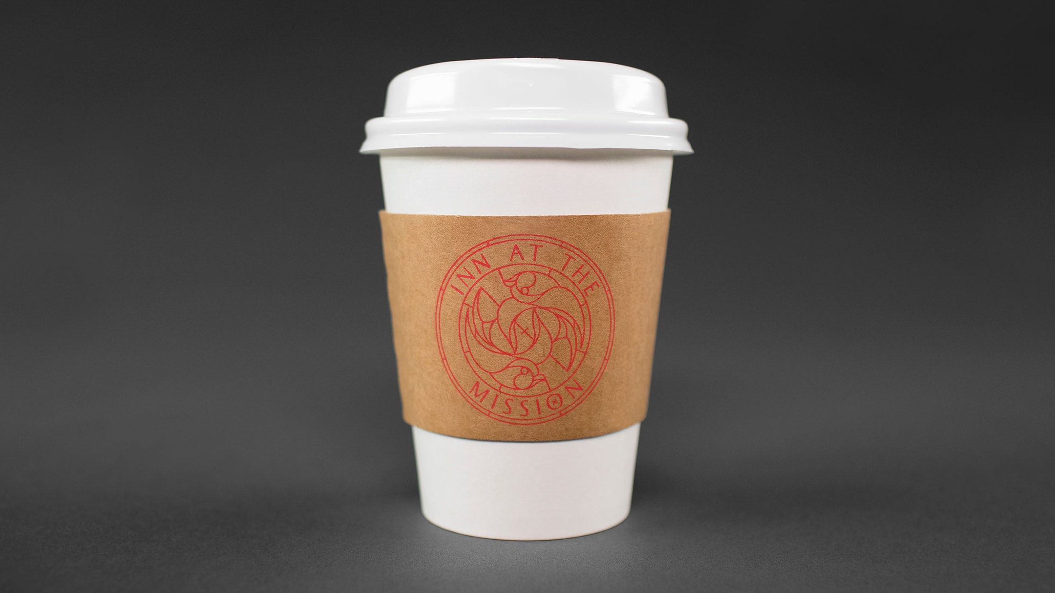 Inn At The Mission branded coffee sleeve