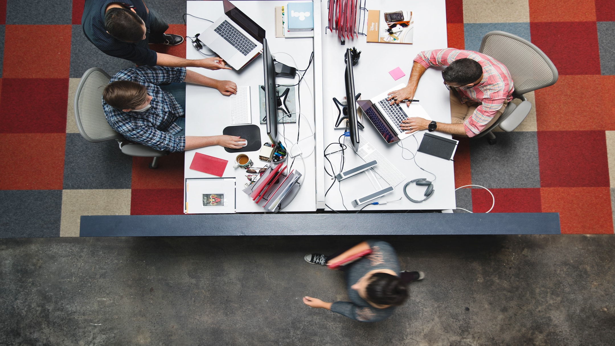 Overhead shot of people at desks working at a branding agency in Tampa