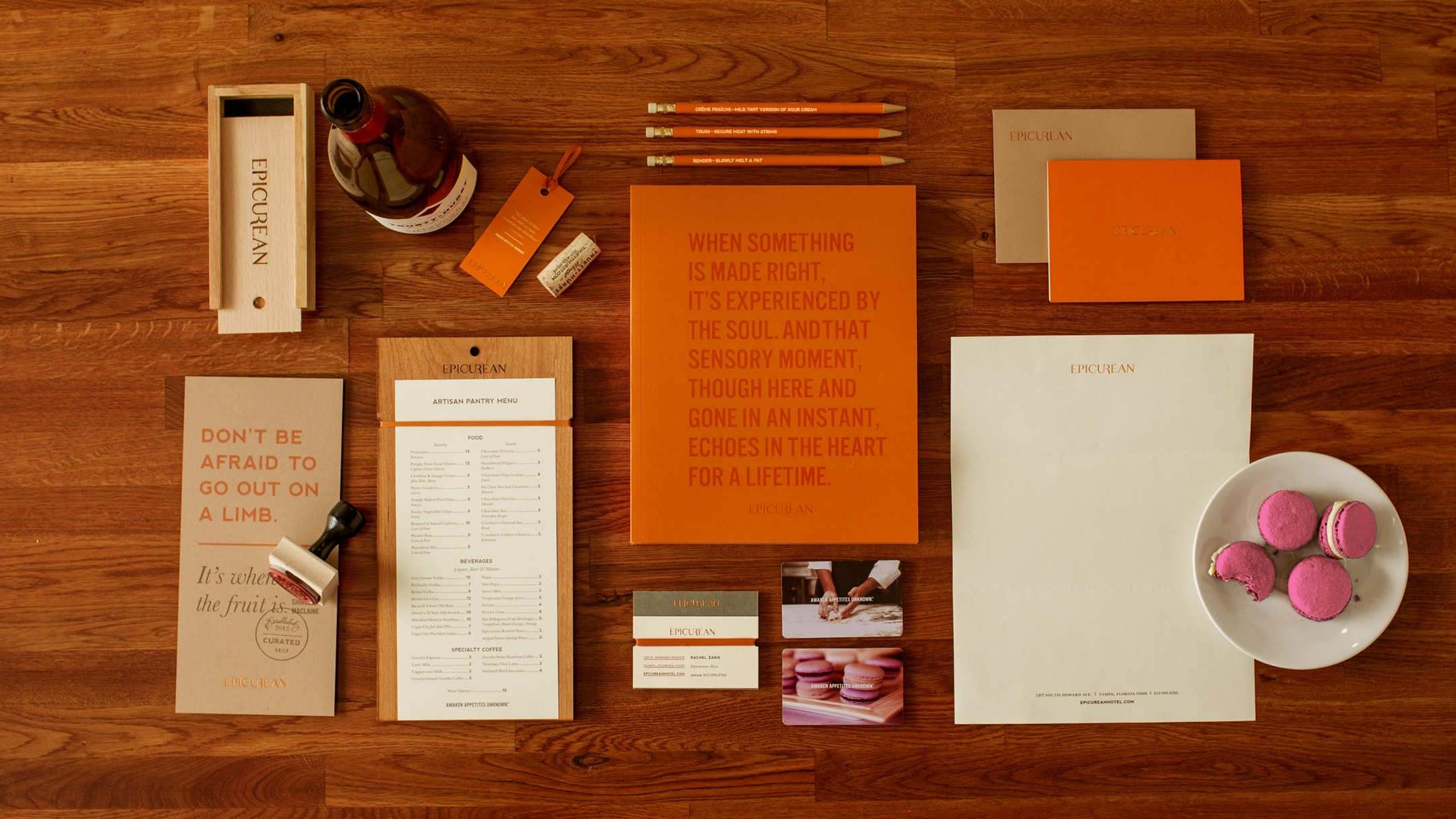 Epicurean Hotel branded collateral including menu and office supplies