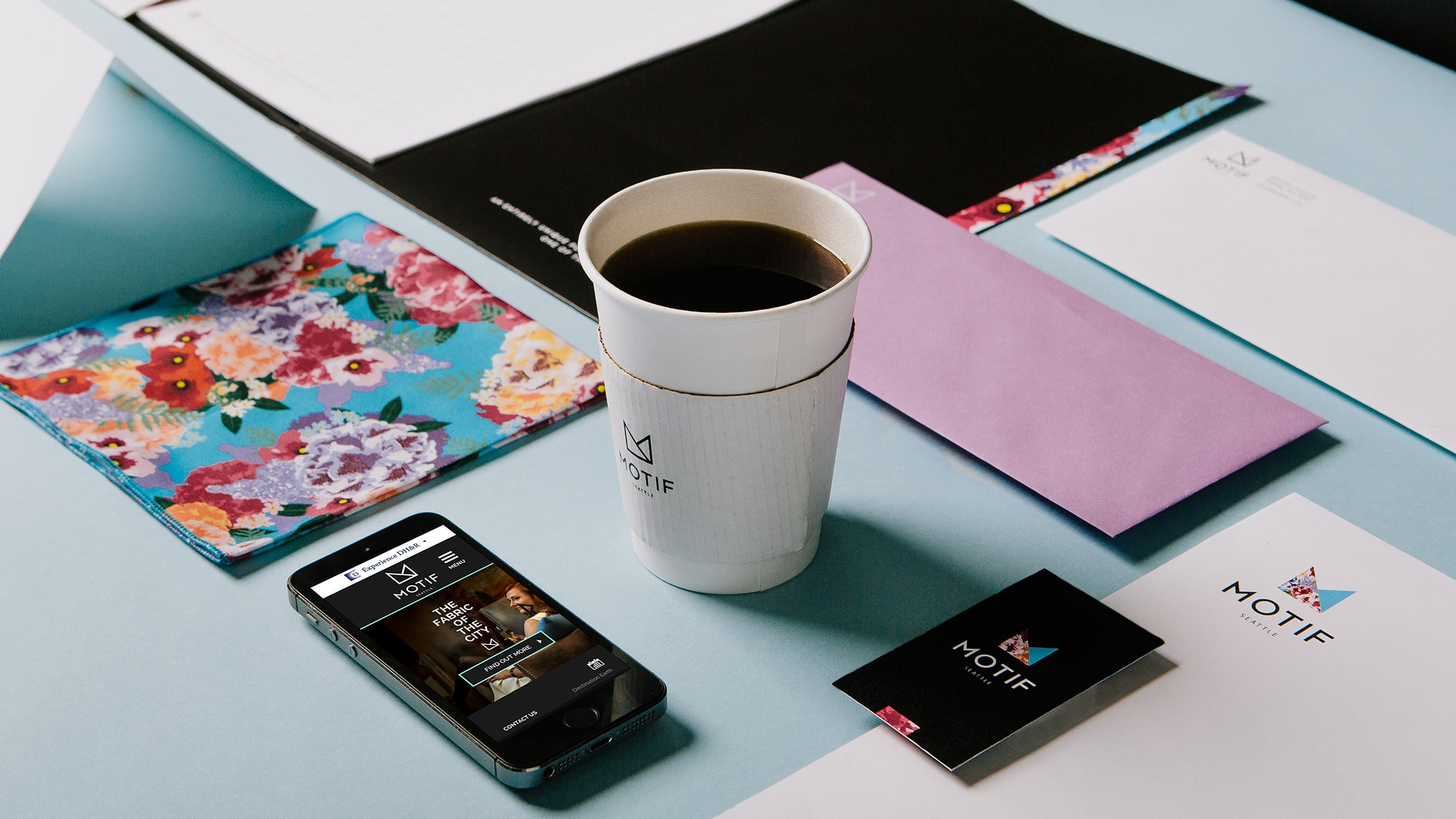 Motif Seattle collateral, iPhone app, and branded coffee cup