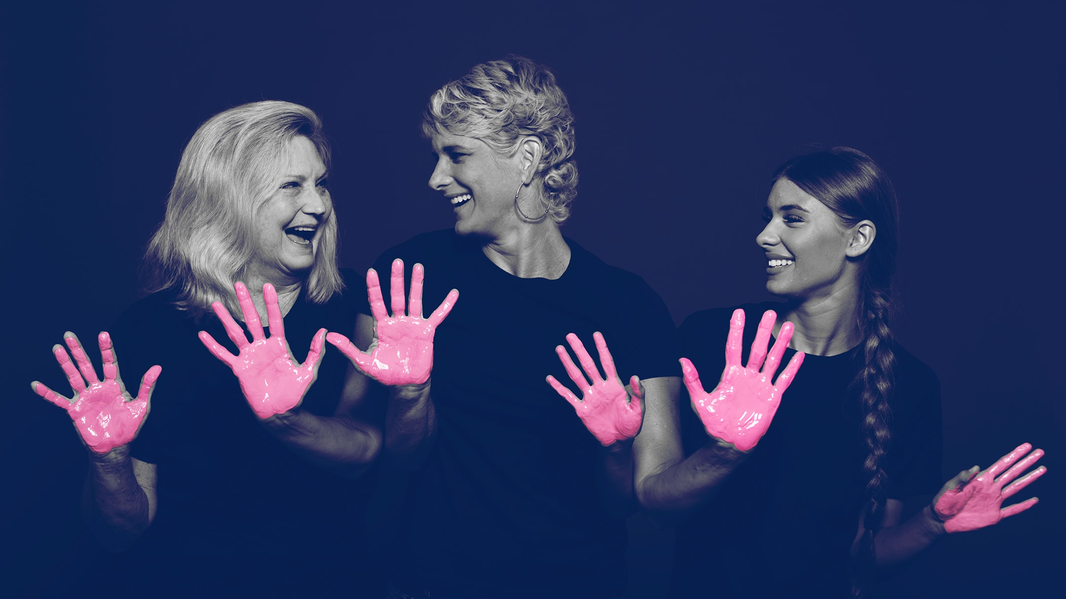 A breast cancer survivor and her family posing for the in our hands campaign with pink paint on their hands