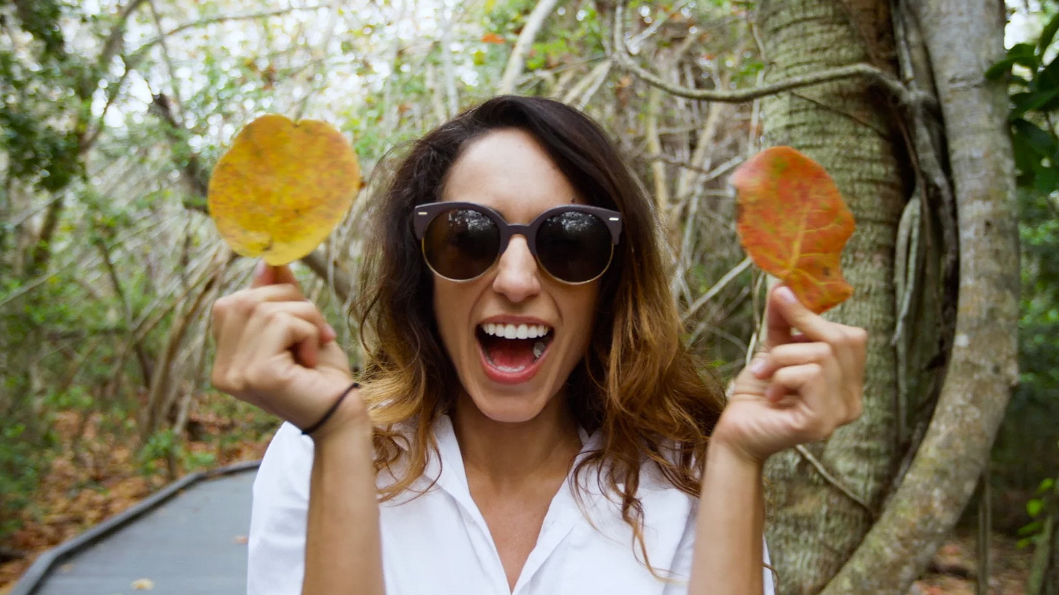 Woman screams with two leaves - a still taken from an influencer marketing video.