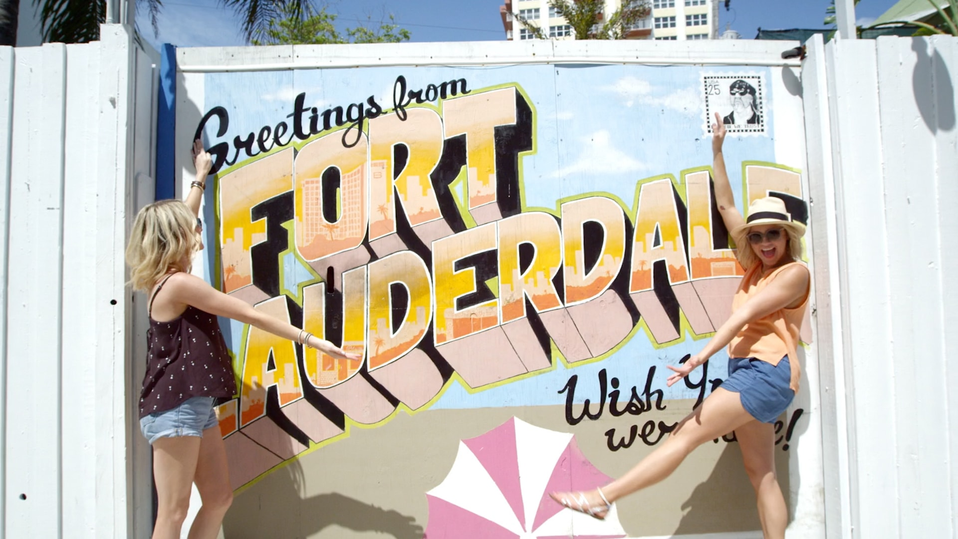 Two white women at Ft Lauderdale postcard mural - a still taken from an influencer marketing video.