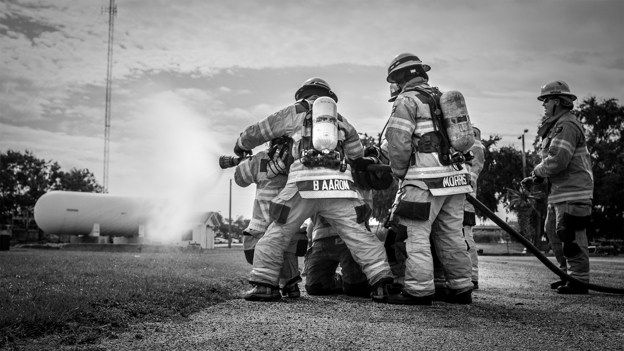 Make-A-Wish Firefighters Using Hose