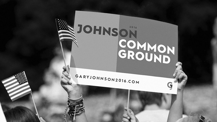 Someone holding a Gary Johnson poster and an American Flag at a rally. Used to showcase how we took consumer insights and created a political campaign.