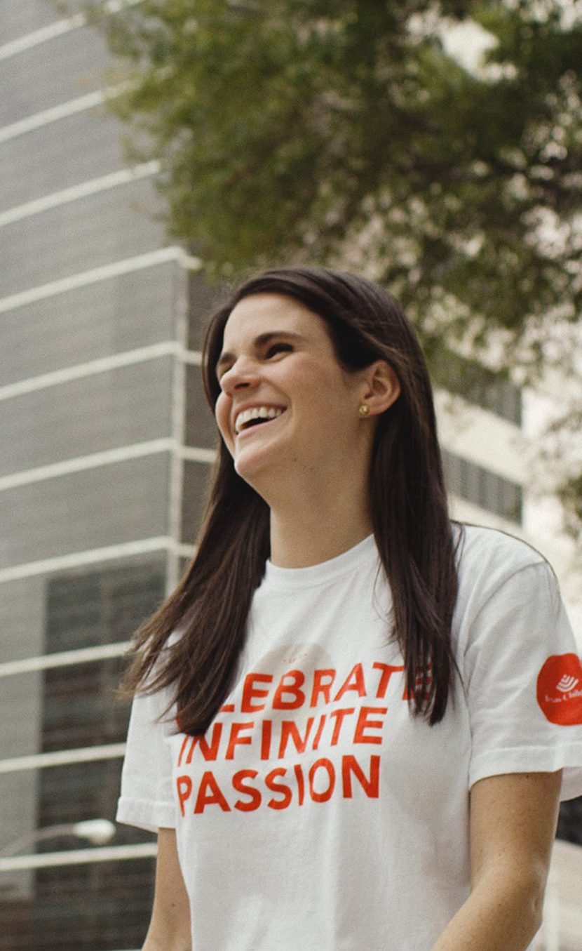 Texas Children's Hospital employee smiling in a culture tshirt.