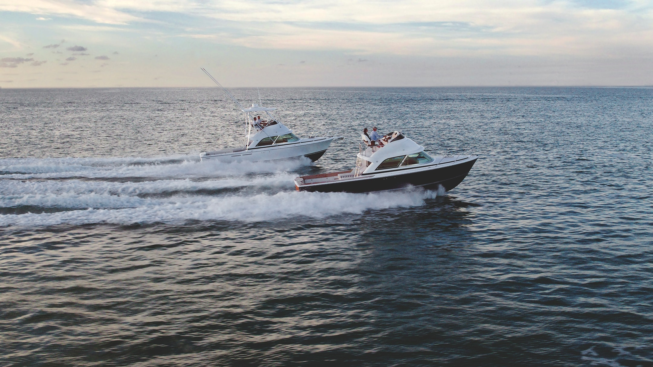 Two boats racing in the water - taken at a shoot for our yacht branding project with Bertram.