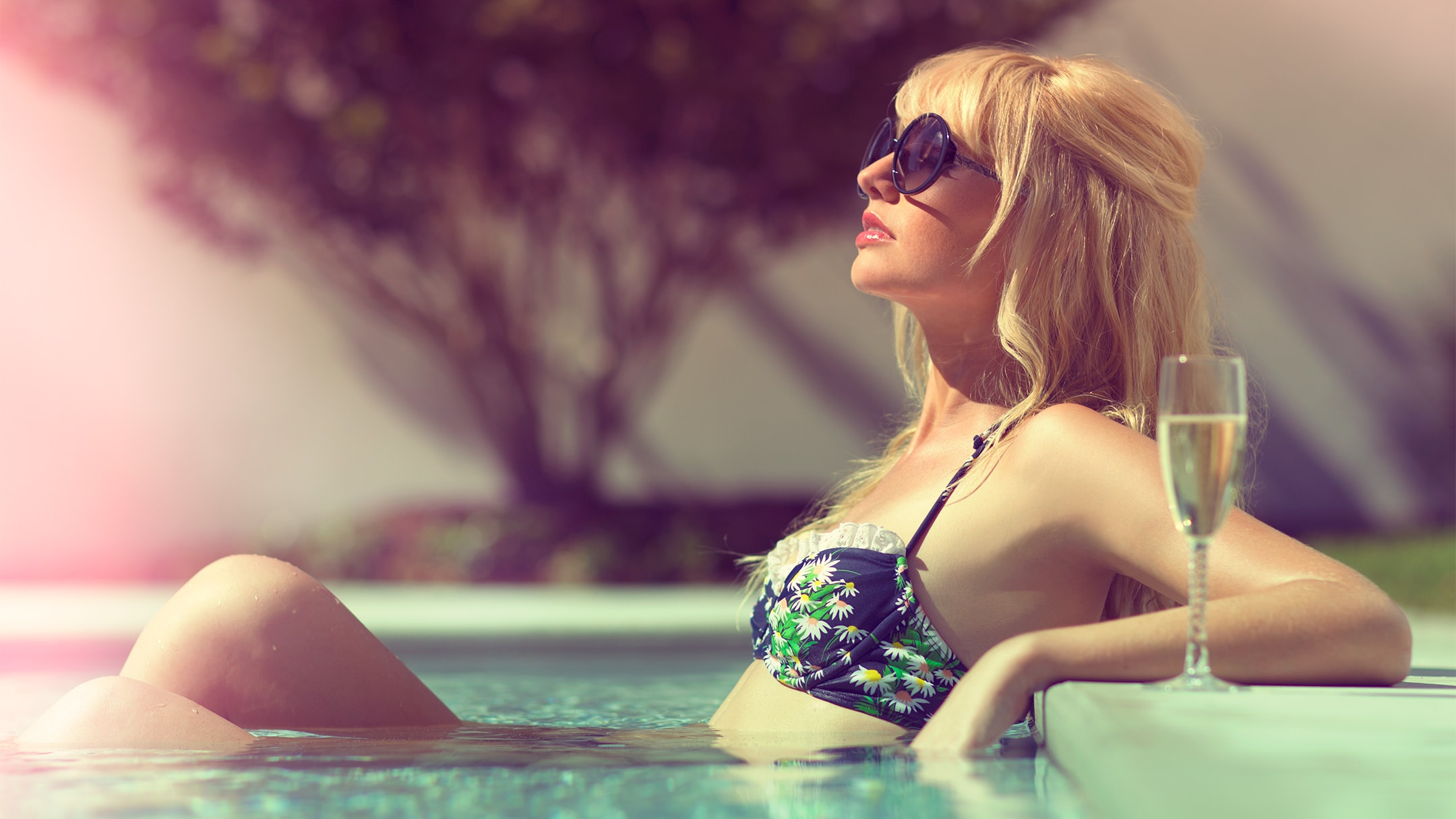 Epicurean Hotel female guest sunbathing