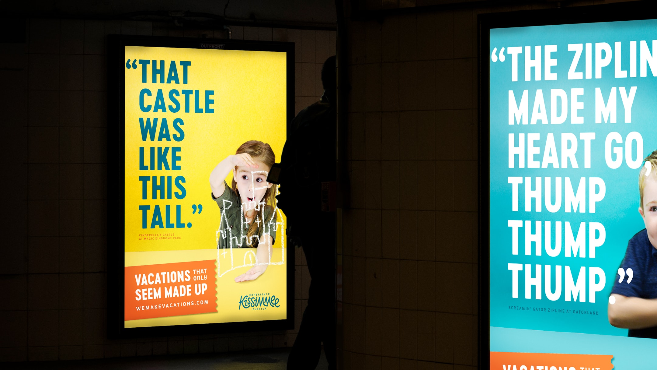 Two experience Kissimmee ads in a bus shelter.