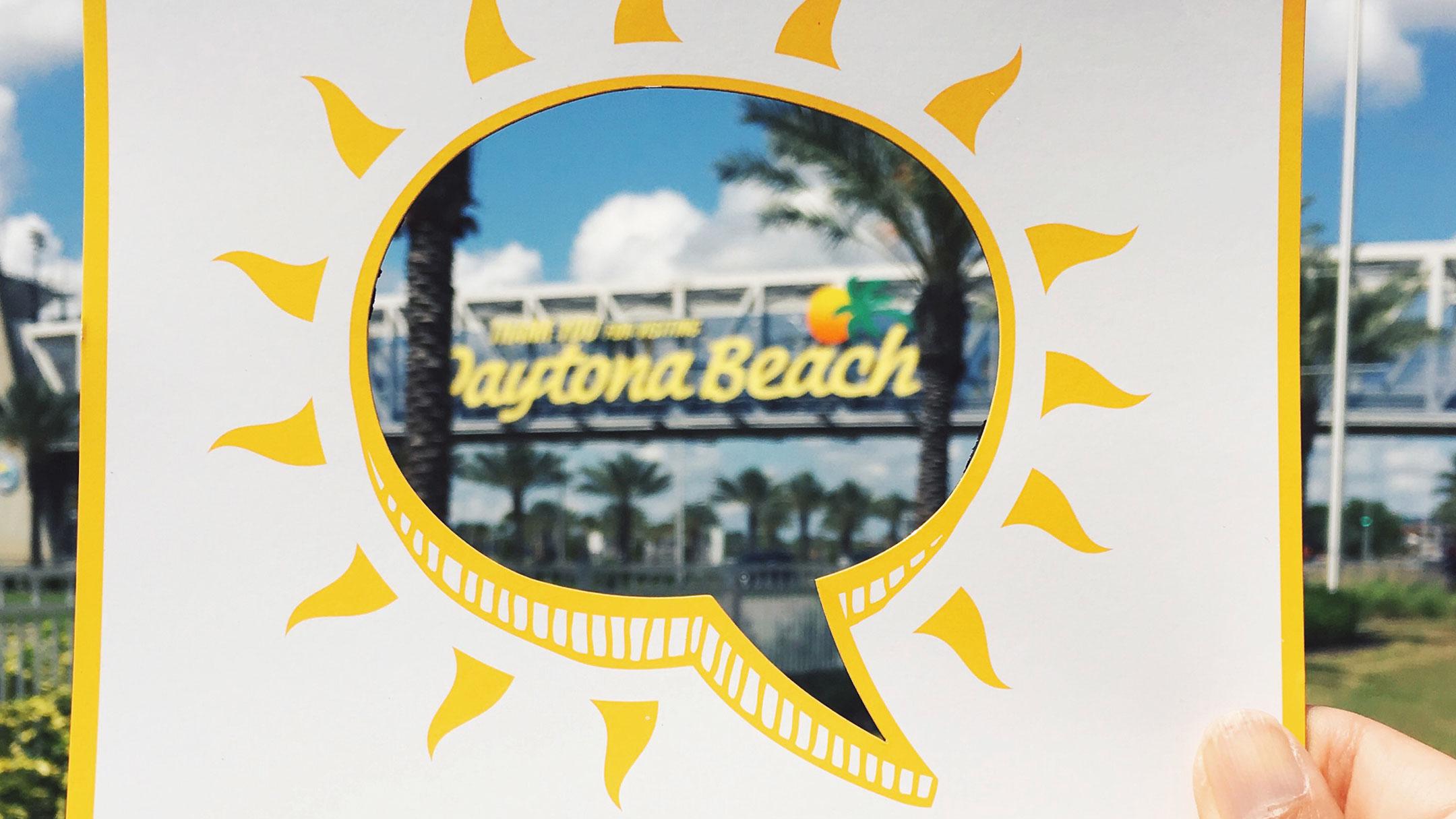 A cut out of a speech bubble highlighting Daytona Beach sign.